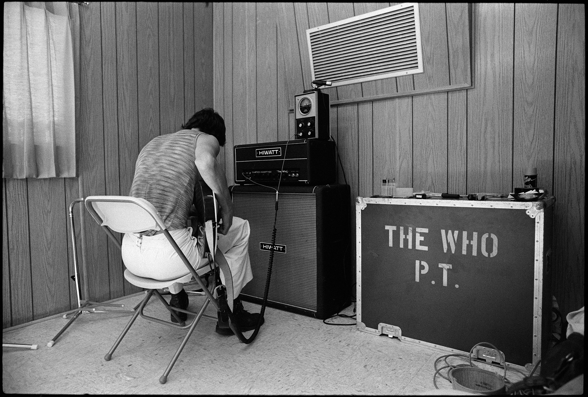 an image of the who guitarist pete townshend with his back to the camera