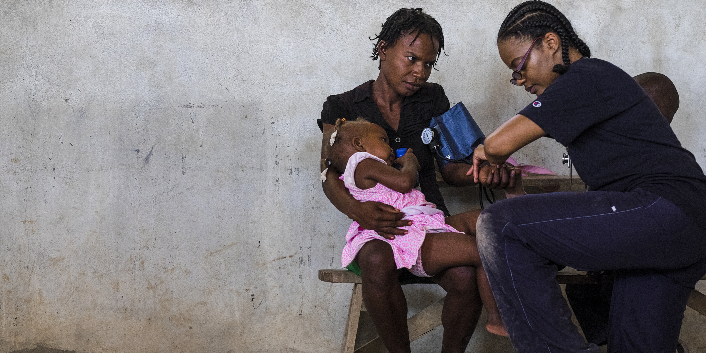 Doctor assisting a mother and child in Haiti