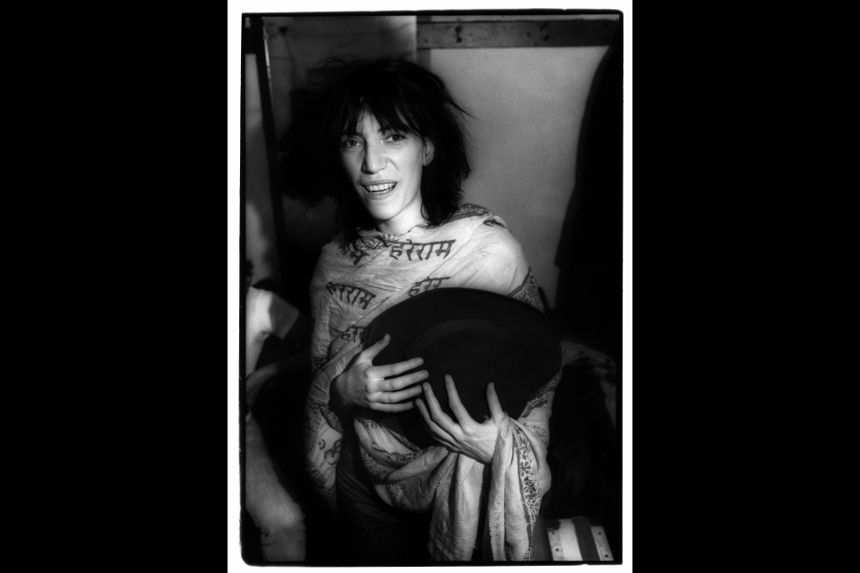 patti smith in a serape holding a hat