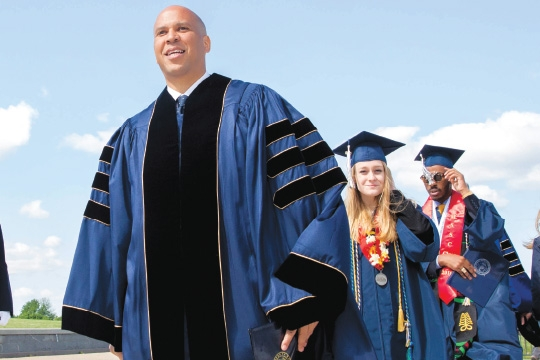 Cory Booker taking the stage at commencement